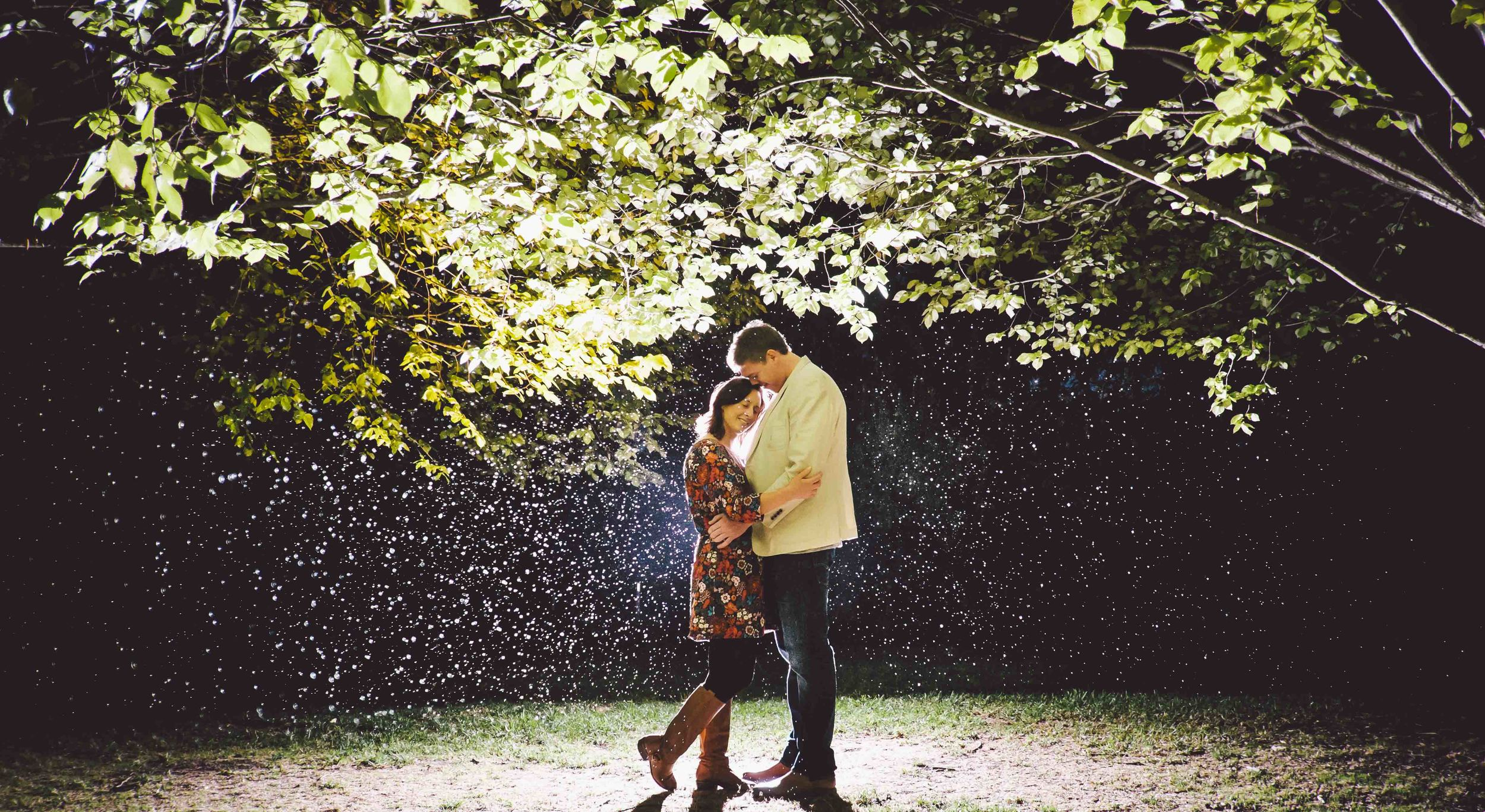 Engagement_Shoot_in_the_rain_under_a _tree_in_beautiful_light.
