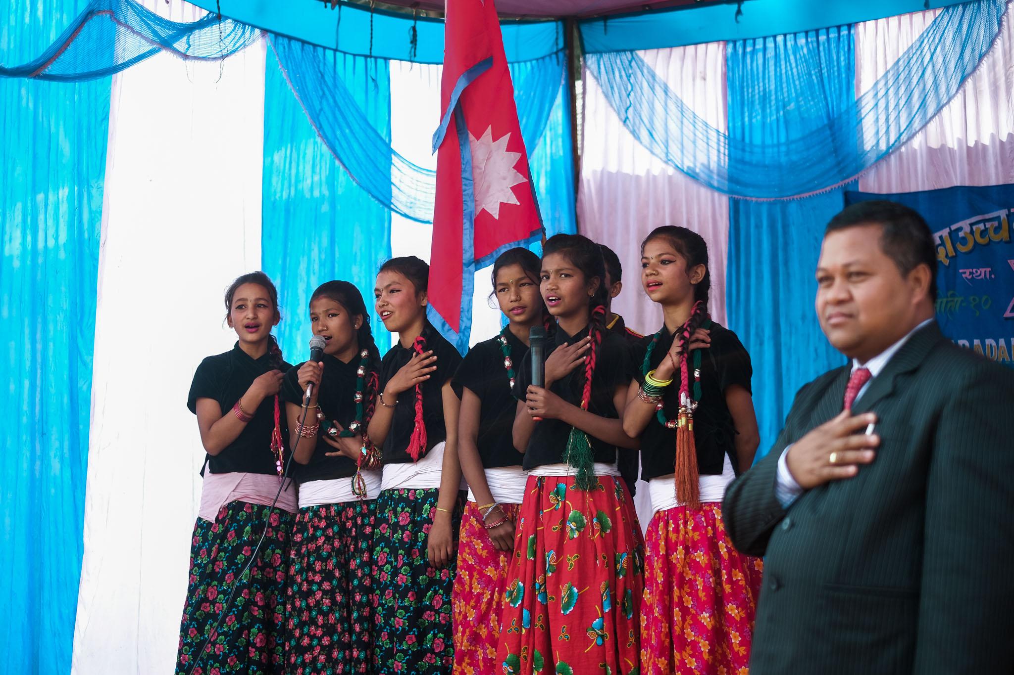 Singing the Napali national Anthem.