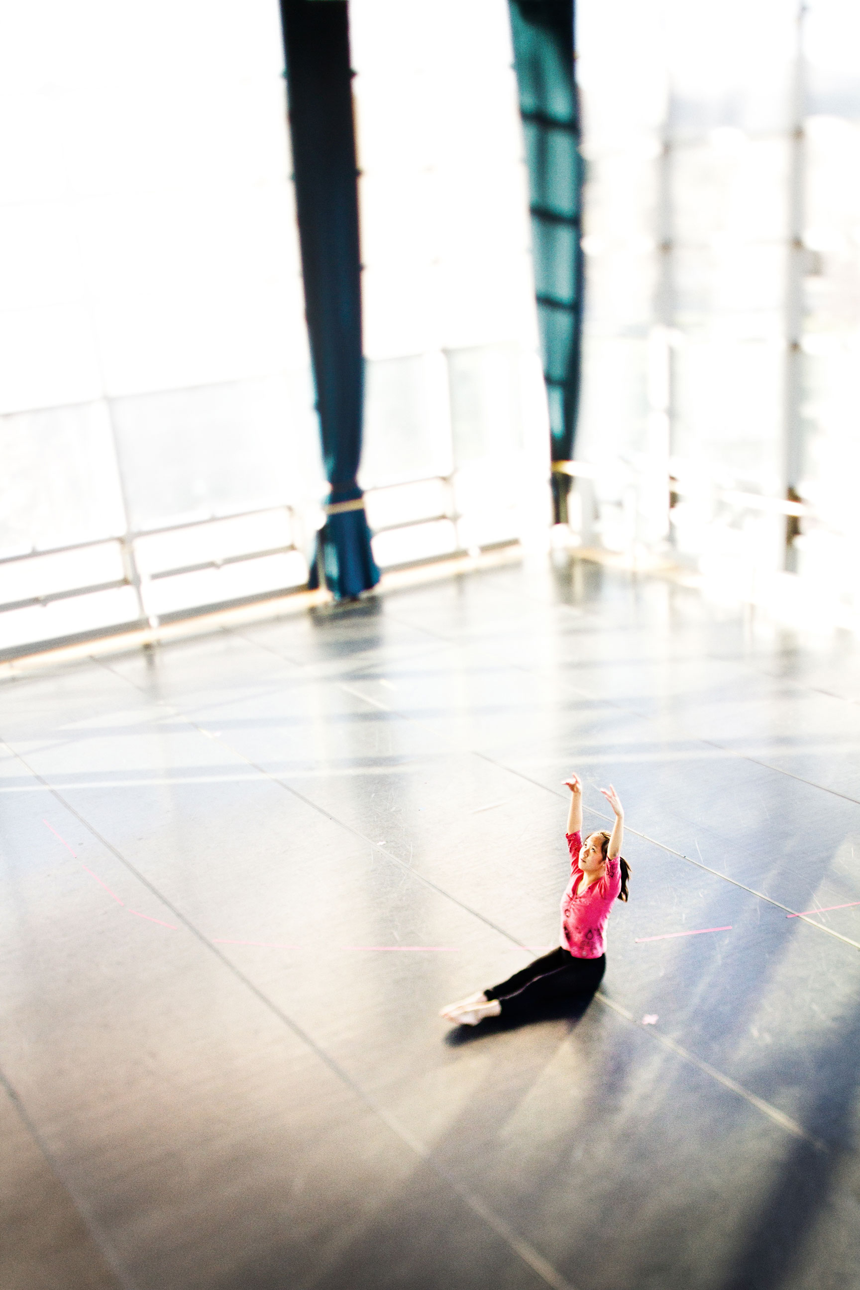 A dance student warms up before class