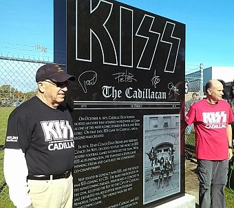 Coaches Dave Brines and Jim Neff with monument.