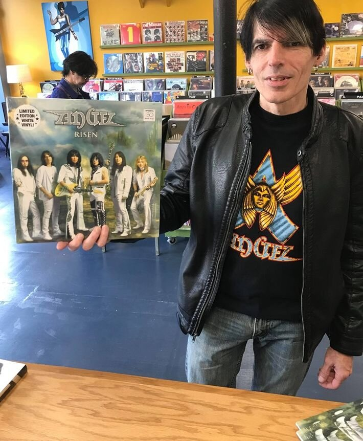 Me purchasing  Risen  on vinyl the day it was released. Photo taken by Brett Ruland (Spoonful Records).