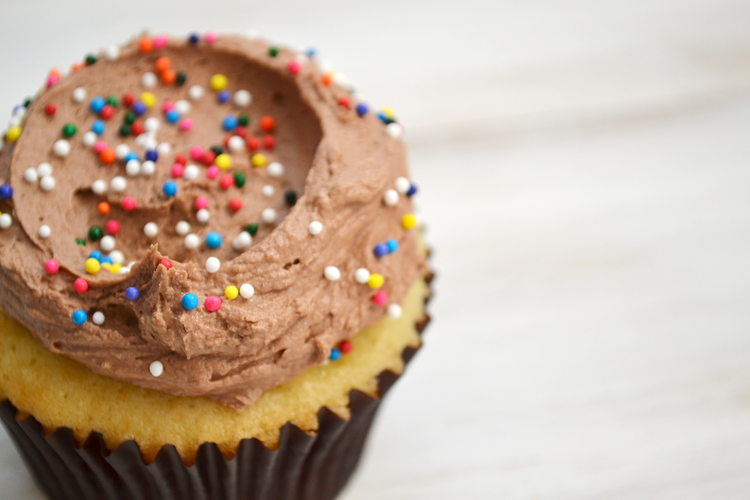 Yellow Cupcakes Topped with Chocolate Frosting