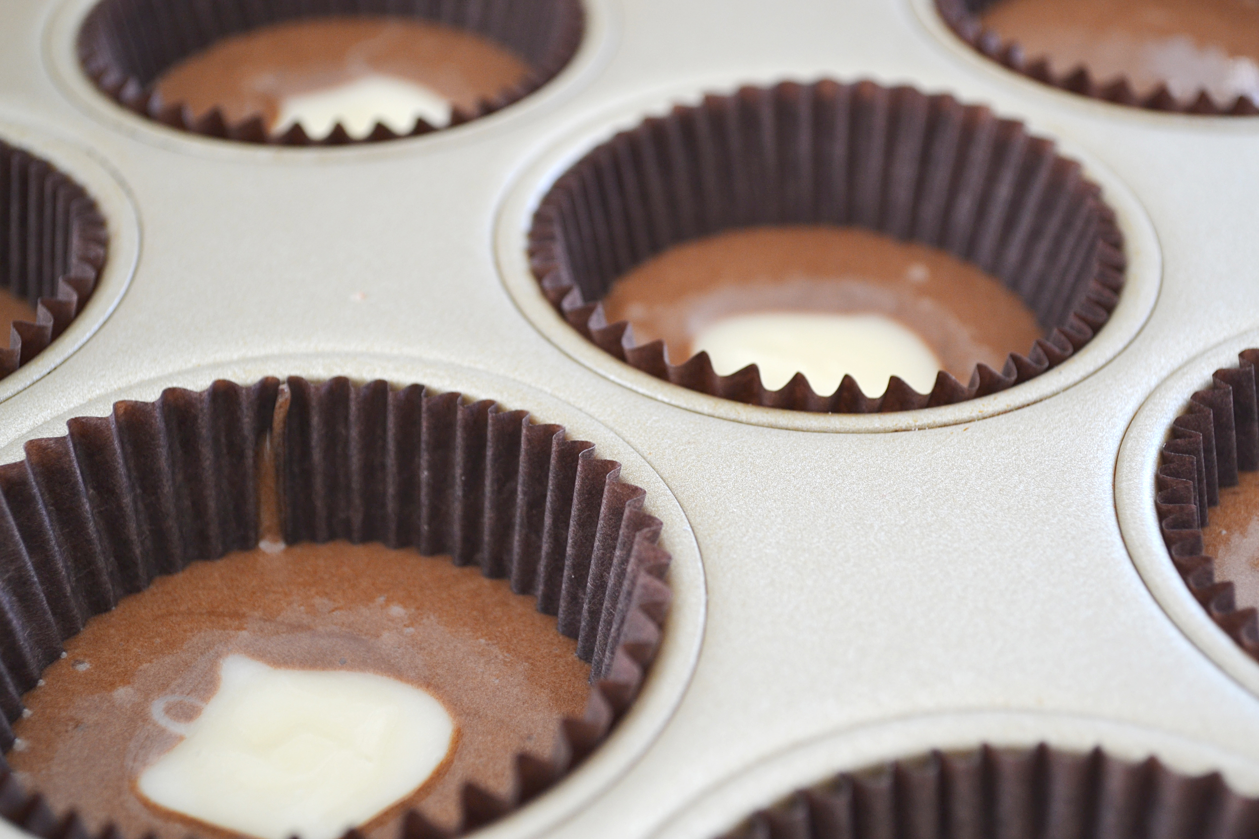 Oreo Dream Cupcakes -- Moist chocolate cupcakes with fluffy frosting made from European-style butter. | thegirlkyle.com