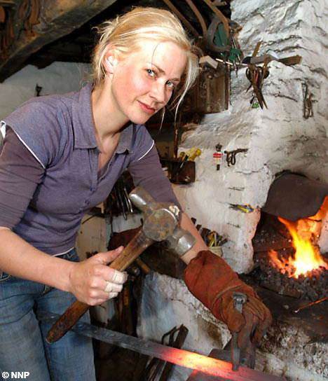 A modern Vulcan hard at work in her forge
