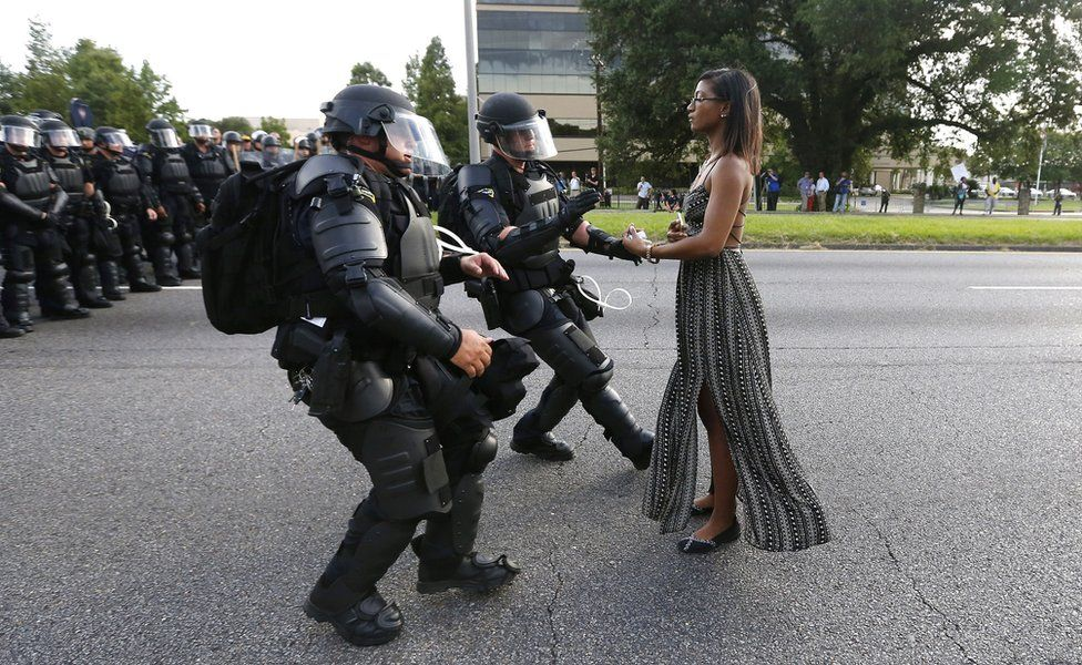I don't know much about this Baton Rouge woman who was photographed calmly facing down police in riot gear at a Black Lives Matter rally.  But to stand in so much authority in one's truth is a sure sign of a Pluto Babe.