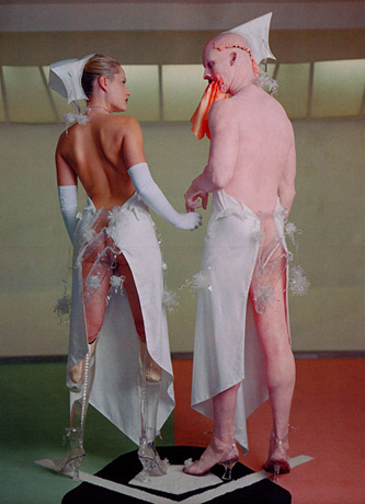Aimee Mullins with artist Matthew Barney for the  Cremaster  film series.  Being a double amputee doesn't prevent her from being a smokin' hot Pluto Babe.