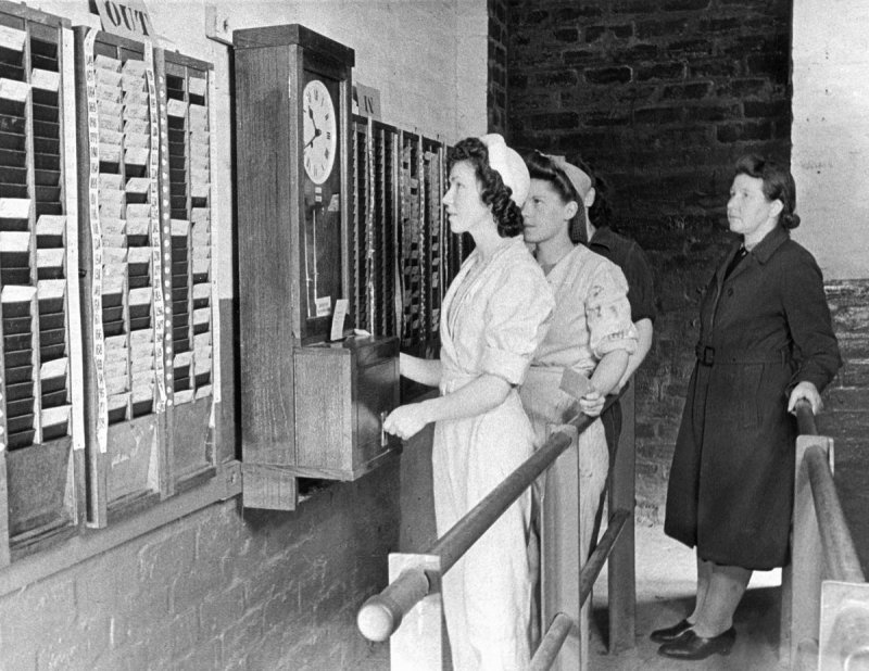W  orkers clocking in to the Bishopton Royal Ordnance Factory,  Renfrewshire.  from collection  Survey of Private  Collections   © RCAHMS    Date 1/1944   Item SC1154561