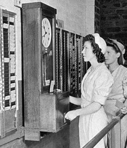 Workers clocking in to the Bishopton Royal Ordnance Factory, Renfrewshire. From collection Survey of Private Collection. RCAHMS. Date 1/1944. Item SC1154561