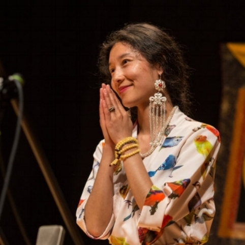 Born in Tibet, Drukmo Gyal Dakini travels the world to sing Tibetan healing mantras and chants
