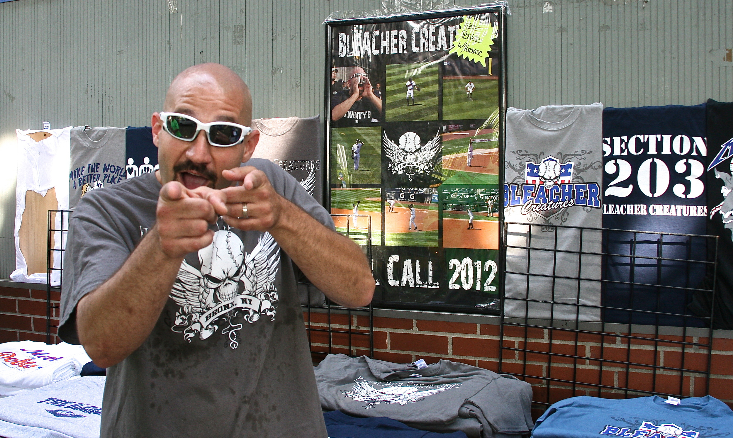 Bald Vinny outside of his t-shirt stand on River Ave.