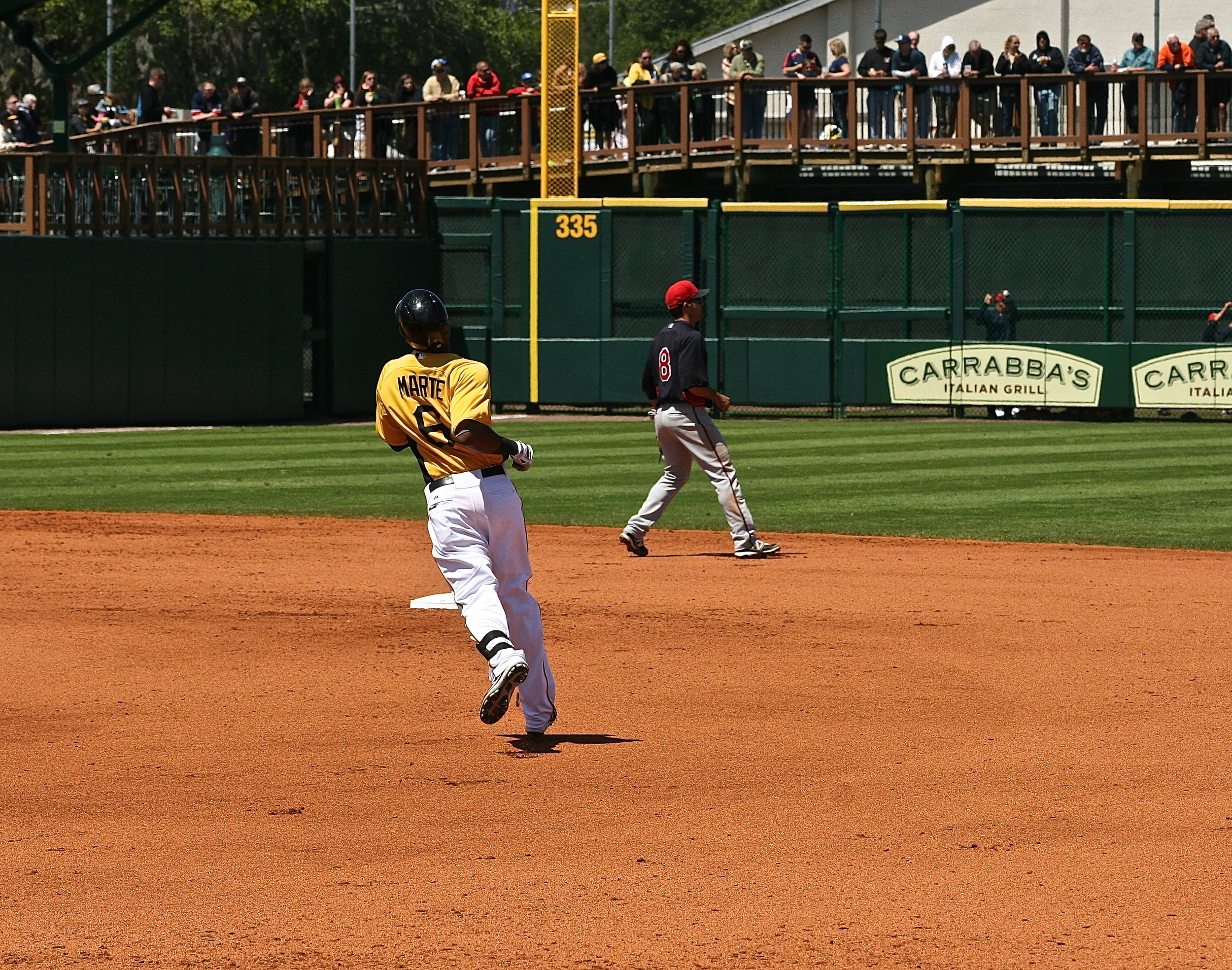 Starling Marte twisting around the bases