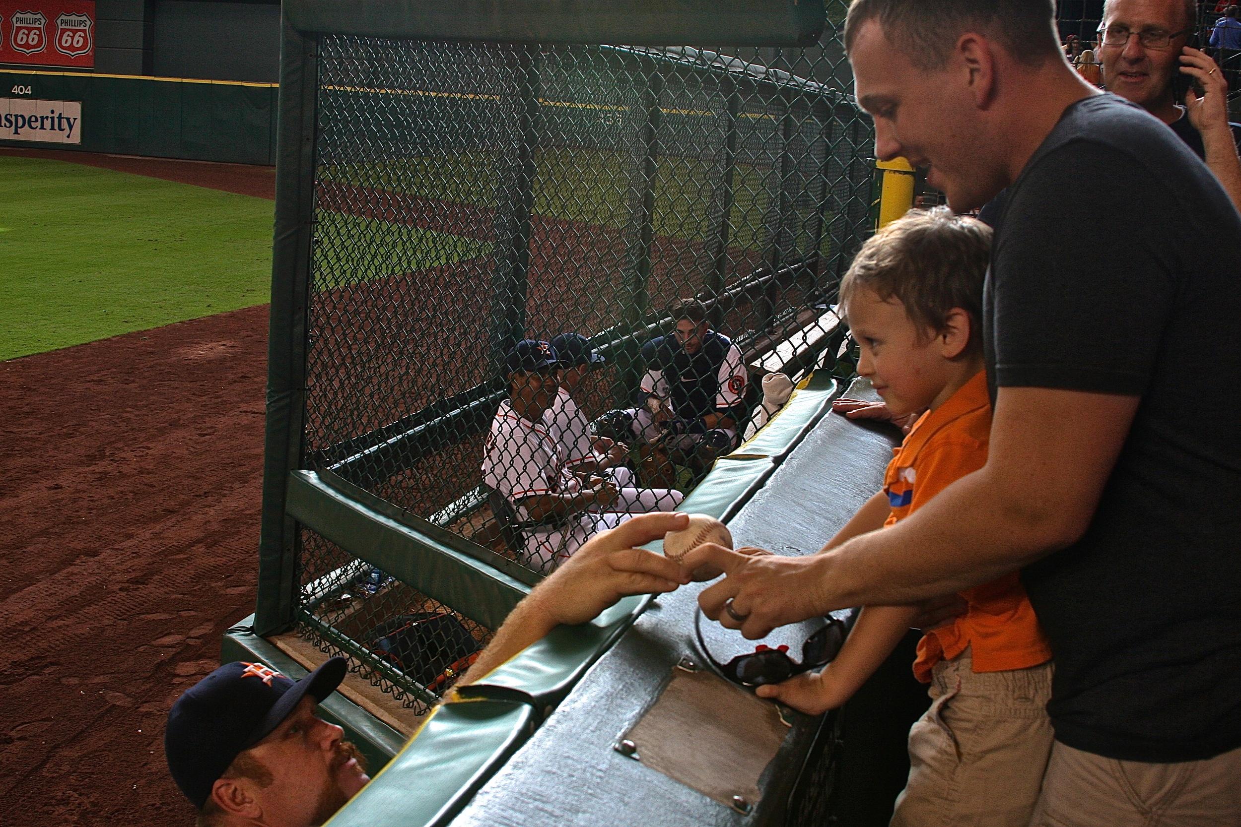 Astros bullpen catcher gives ball to fan
