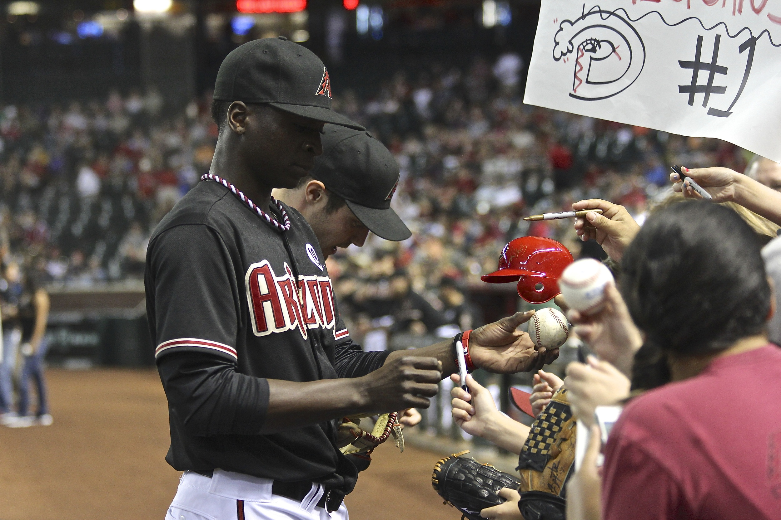 Didi Gregorious signs for some kids