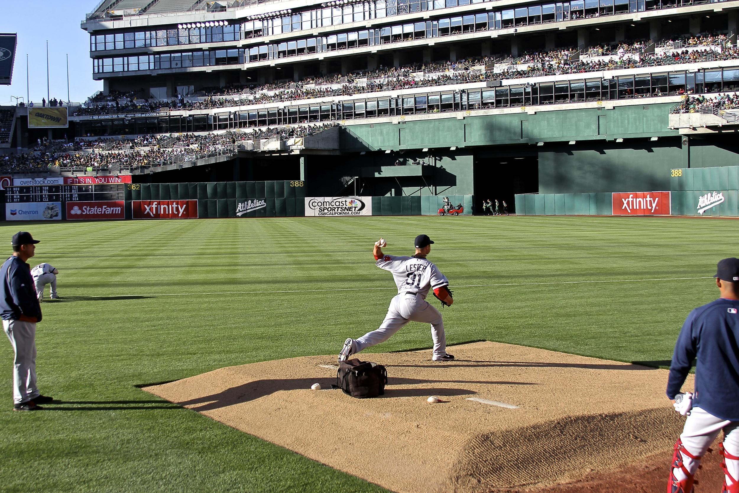 Jon Lester warms up in the bullpen