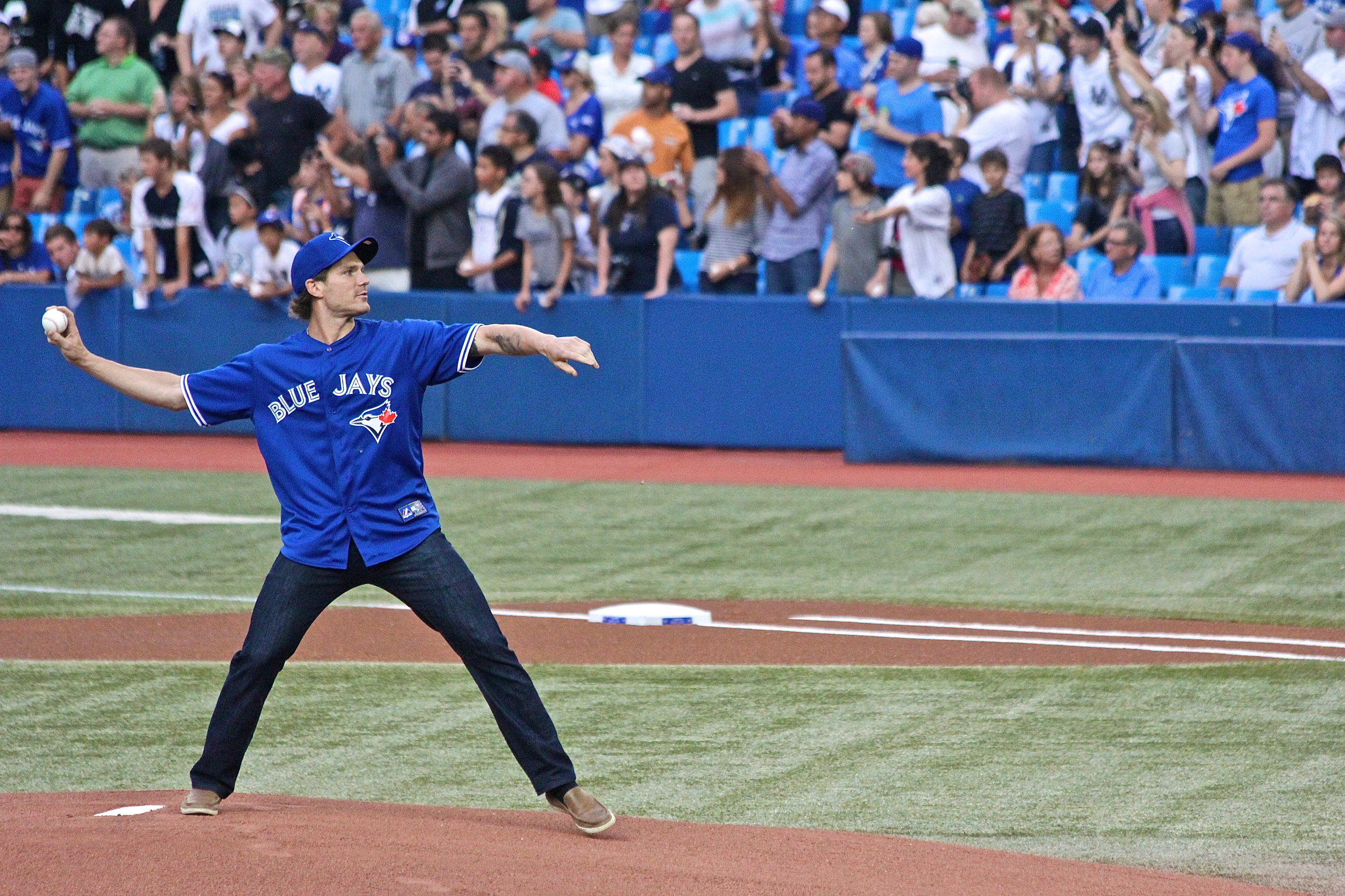Toronto Maple Leafs forward David Clarkson throws out the first pitch