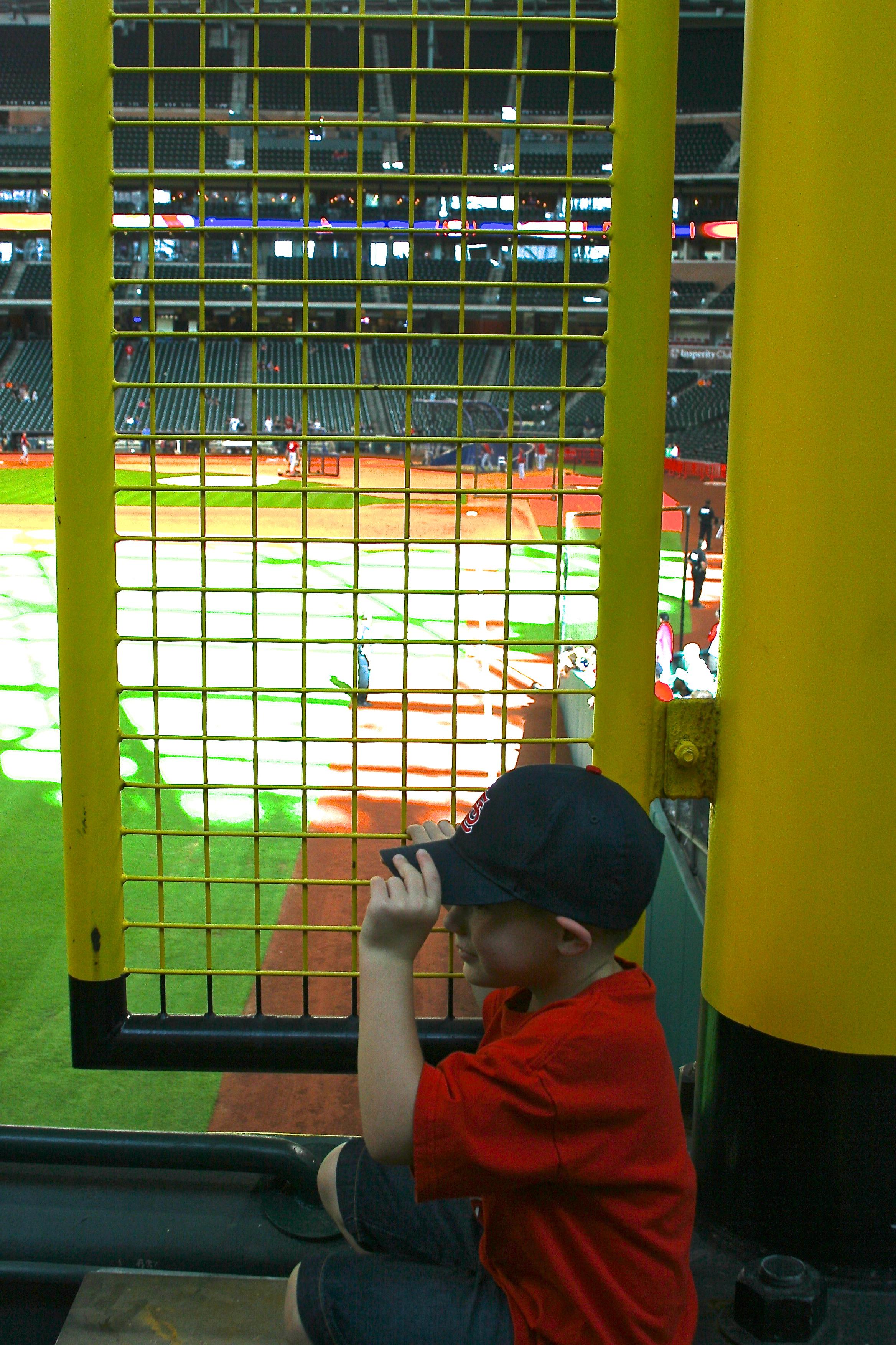 Kid hiding behind the foul pole