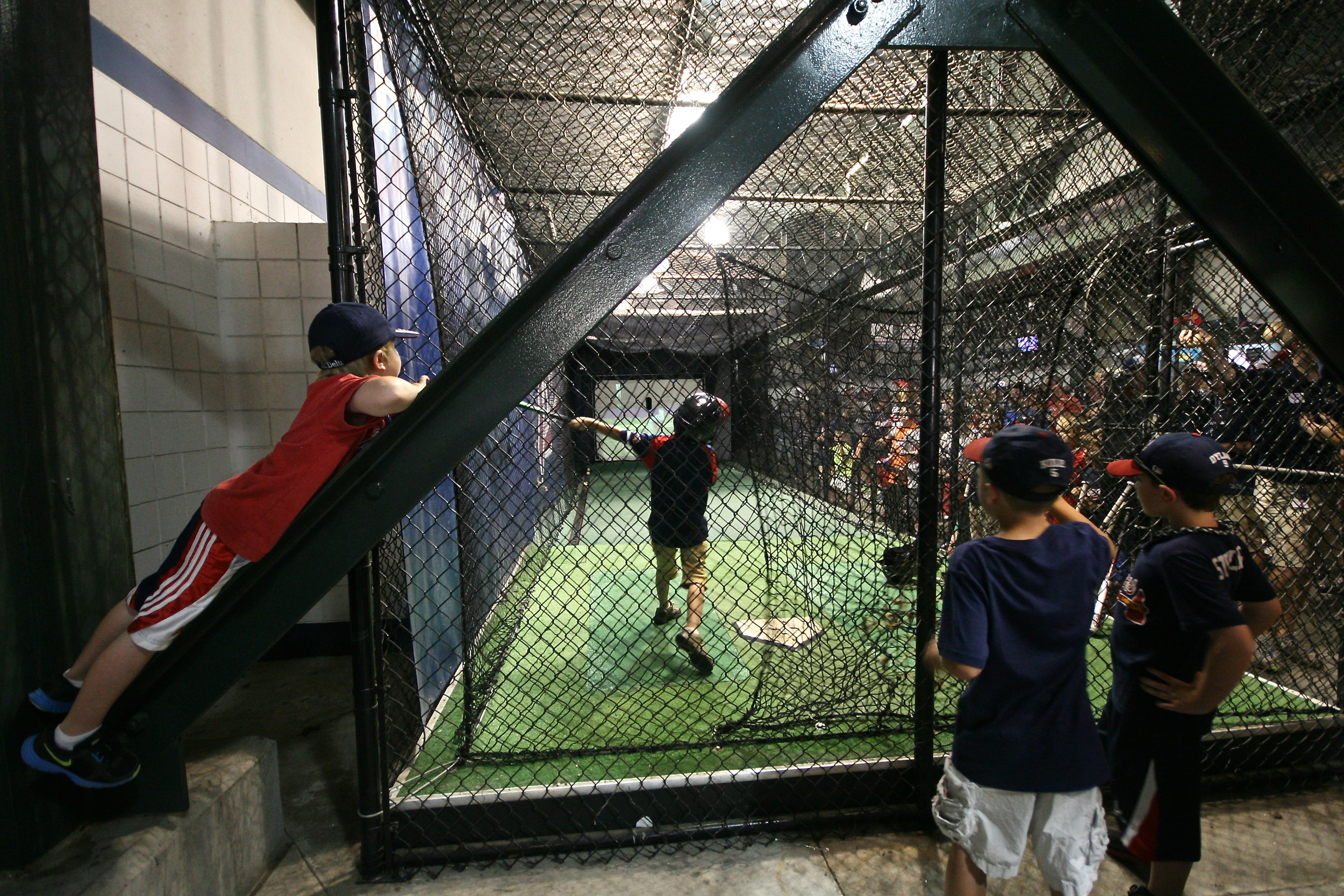 Kids hitting the batting cages