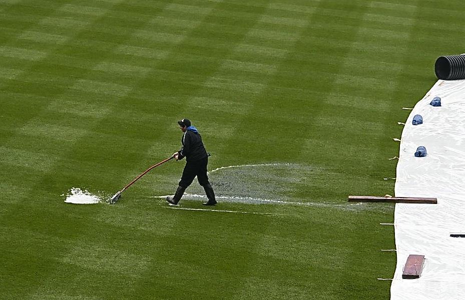 Sweeping the rain away