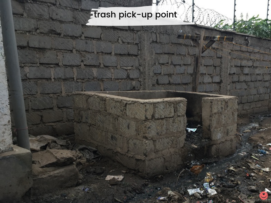 Trash pick-up point, built by Malezi Centre.