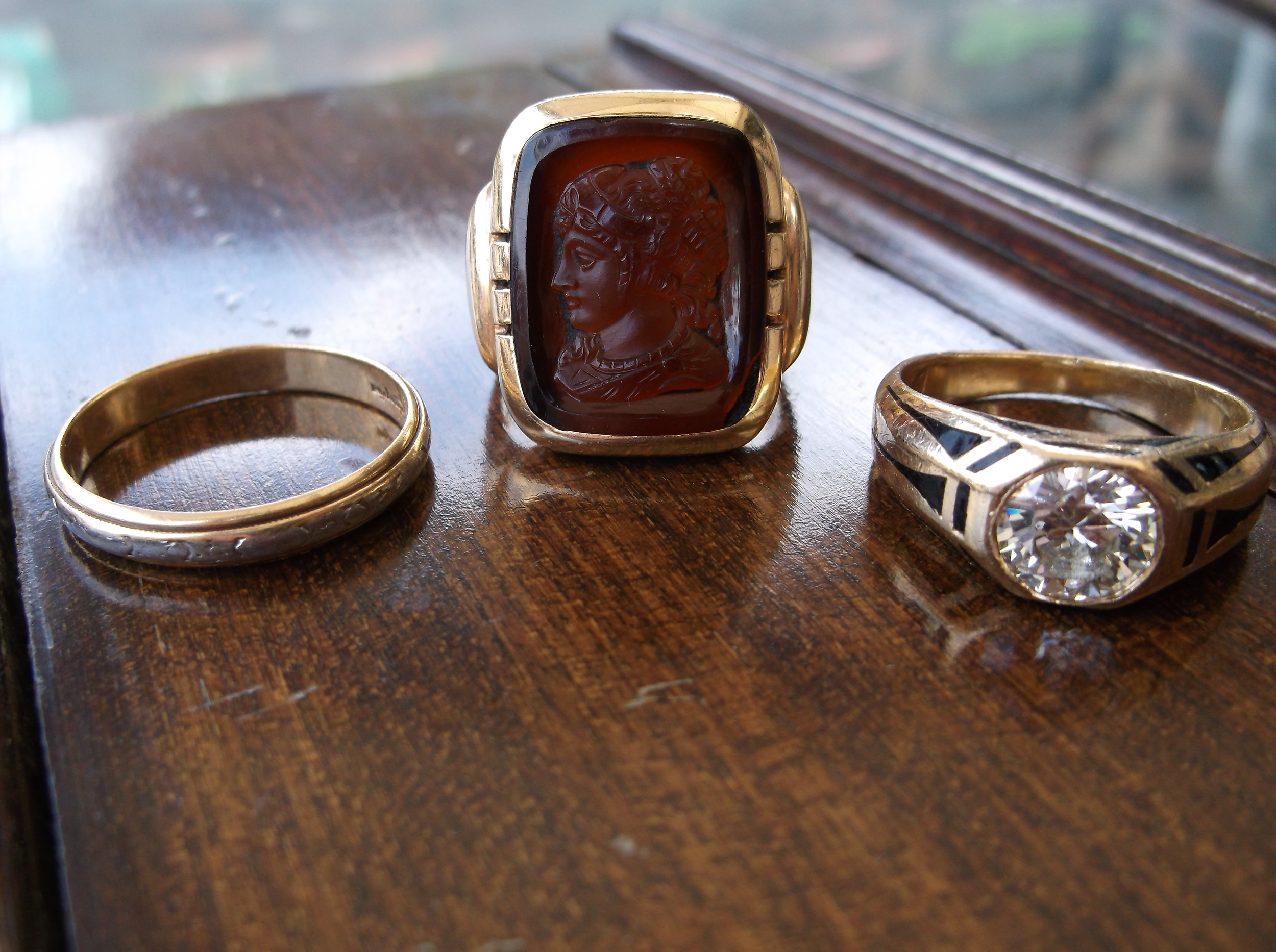 From left to right:  1920's 14K yellow and white gold men's band, Carnelian intaglio 14K yellow gold men's ring, SOLD - all original Art Deco 1.48 carat diamond and black enamel men's ring.