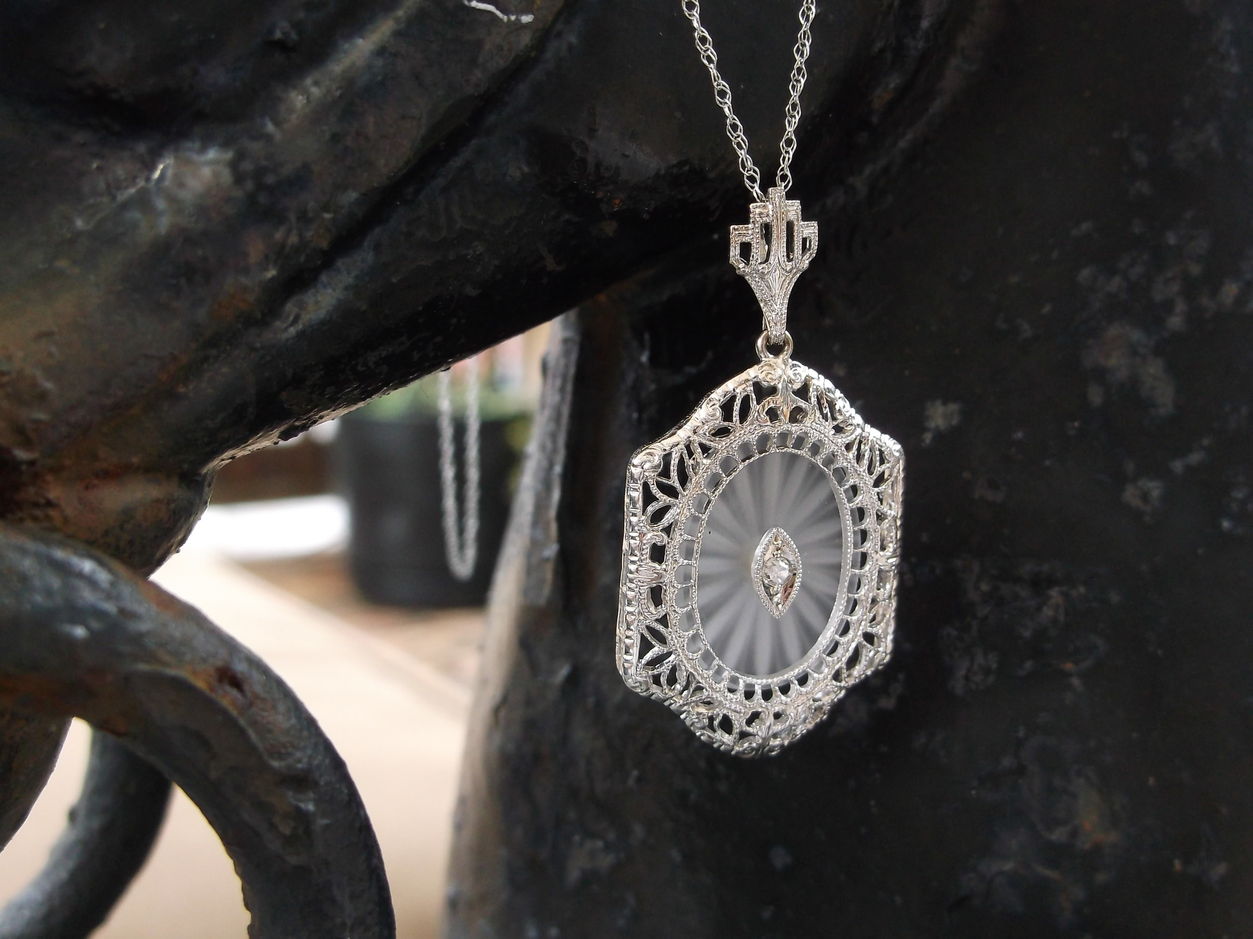 SOLD - Gorgeous Art Deco carved quartz set in an intricate white gold pendant with a diamond in the center.