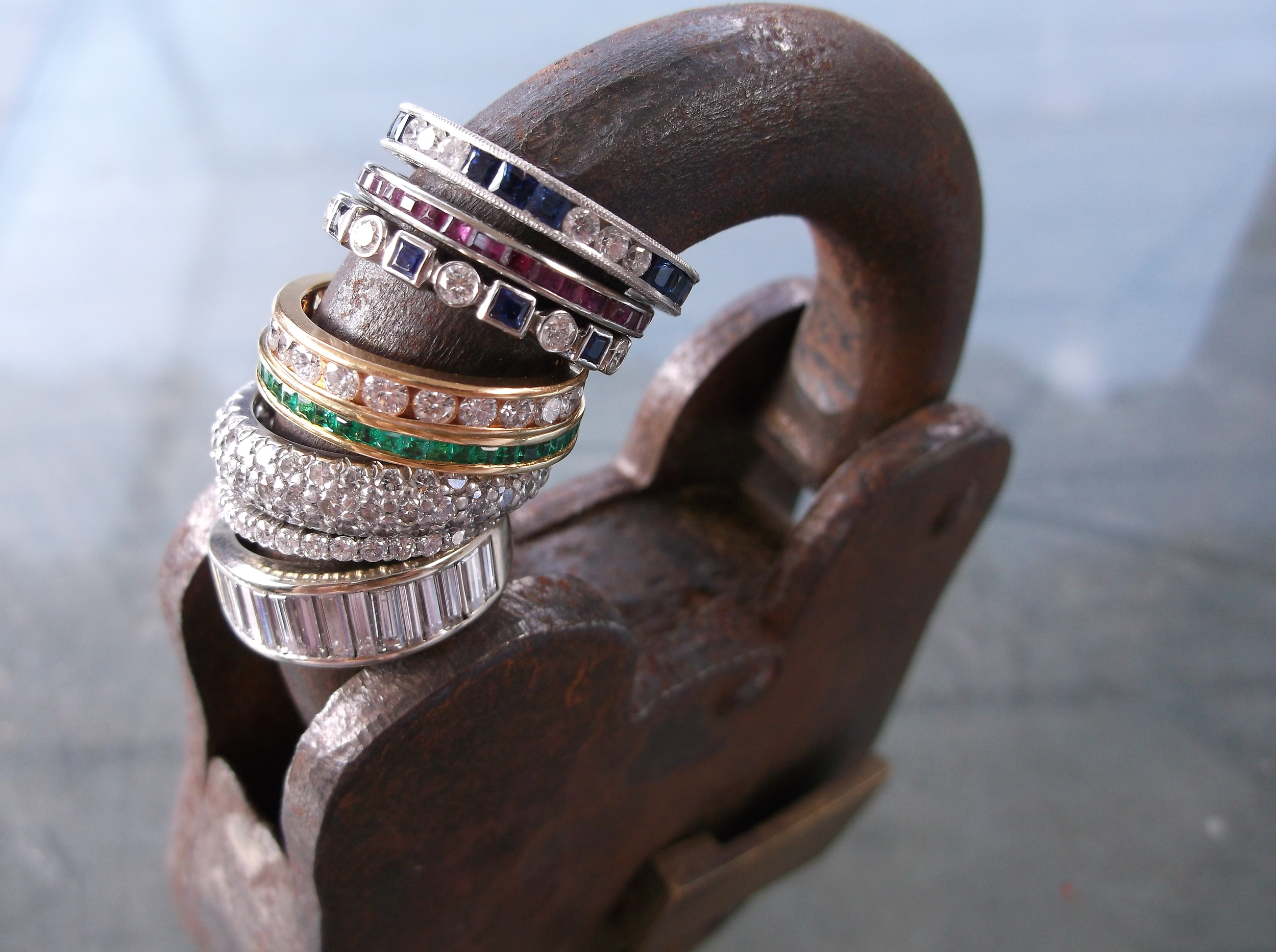 Gorgeous and playful array of diamond, emerald, ruby and sapphire bands in platinum, yellow and white gold.