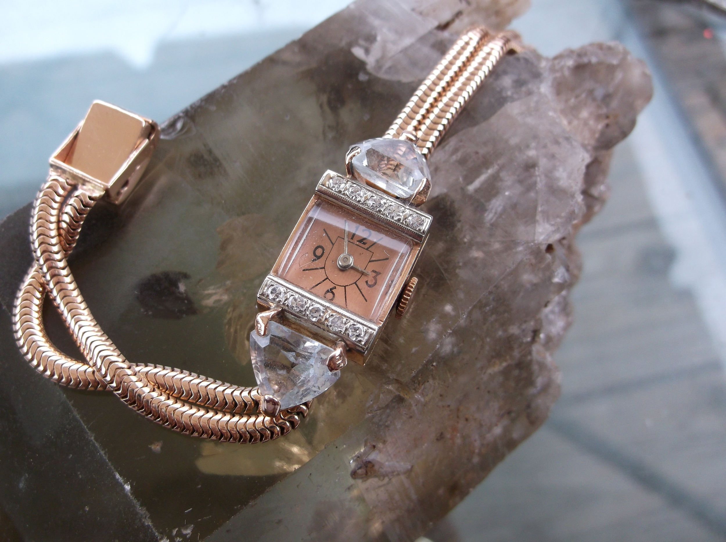 SOLD - 1940's Retro rose gold watch with large aquamarine stones and diamond accents.