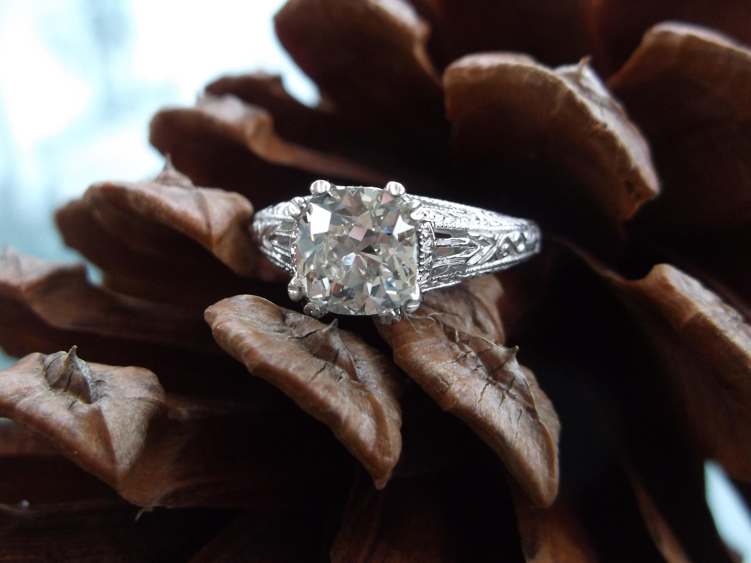 SOLD - Elegant 1.27 carat Old Mine cut diamond set in a beautiful white gold filigree setting.