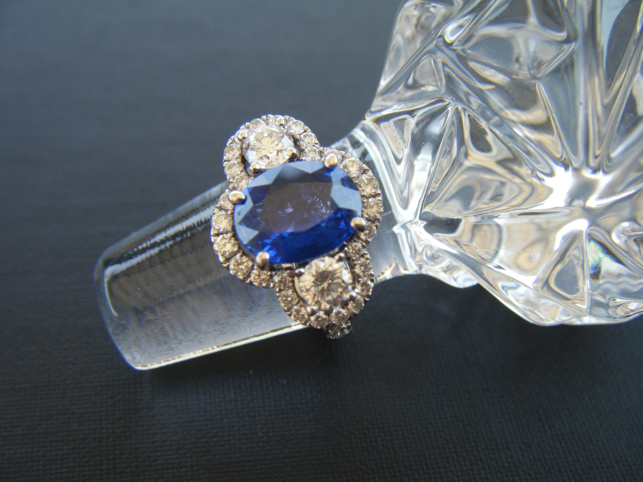SOLD - Beautiful diamond and sapphire ring with a 2.03 carat sapphire in the center and a 0.44 carat diamond on each side set in 18K white gold.