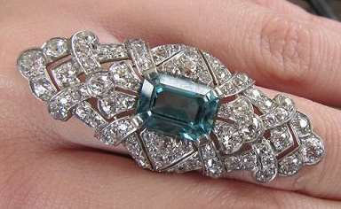 Sheryl's right hand: Art Deco diamond and blue zircon cocktail ring.