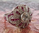 Sheryl's left hand: Art Deco diamond and ruby cocktail ring.