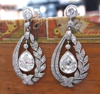 Sheryl's earrings: Art Deco pear shaped diamond earrings.