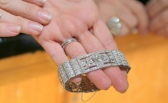 Sheryl's left wrist bottom: Art Deco diamond and platinum bracelet.