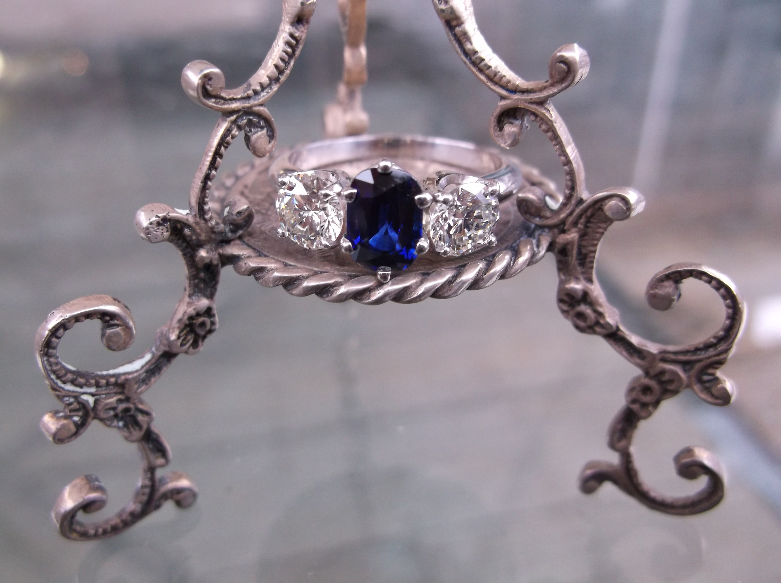 SOLD - Vivacious sapphire and diamond ring set in white gold with a 1.22 carat sapphire and 1.20 carats total weight in diamonds.