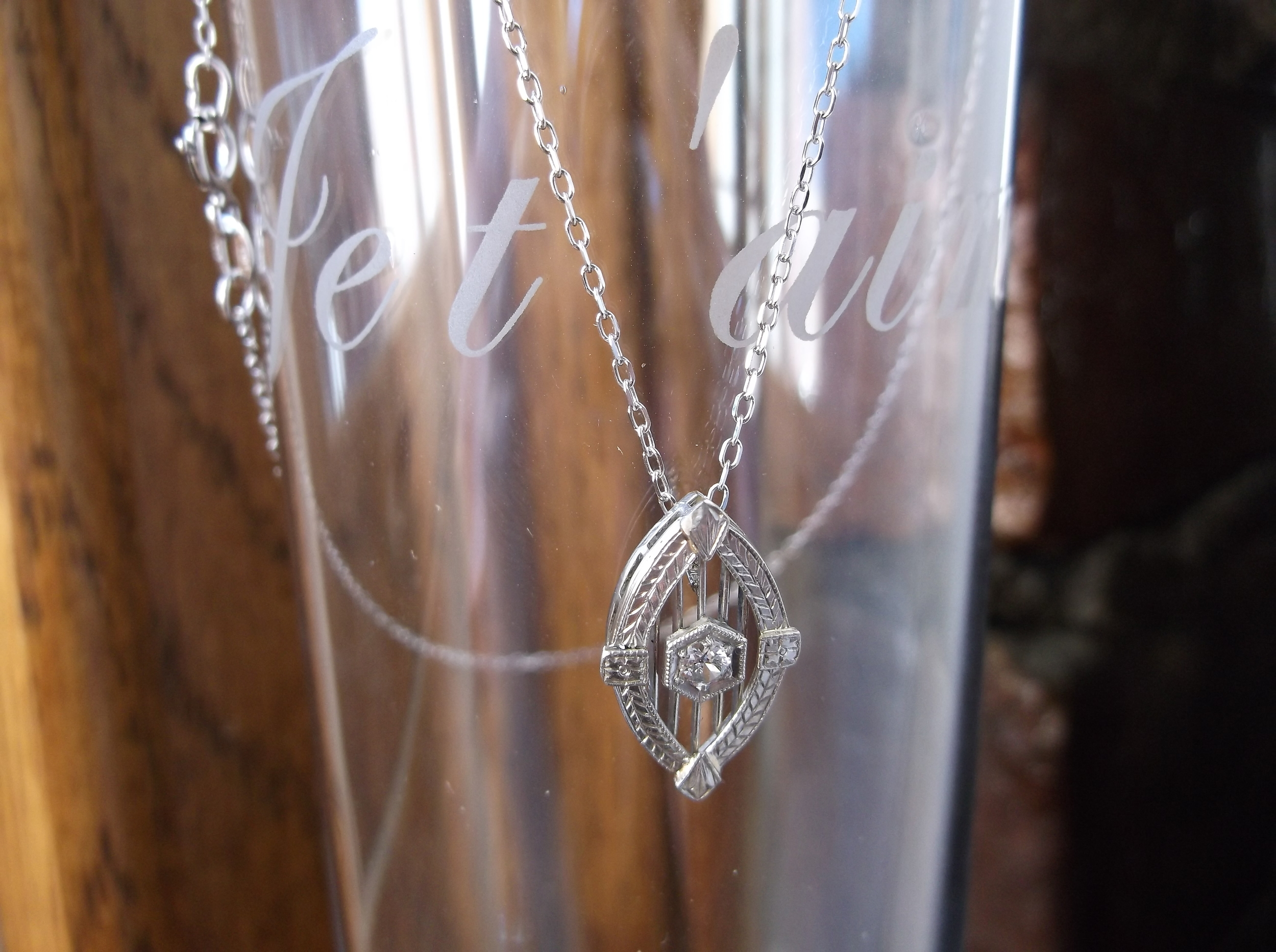 SOLD - Lovely 1920's diamond filigree pendant in white gold.