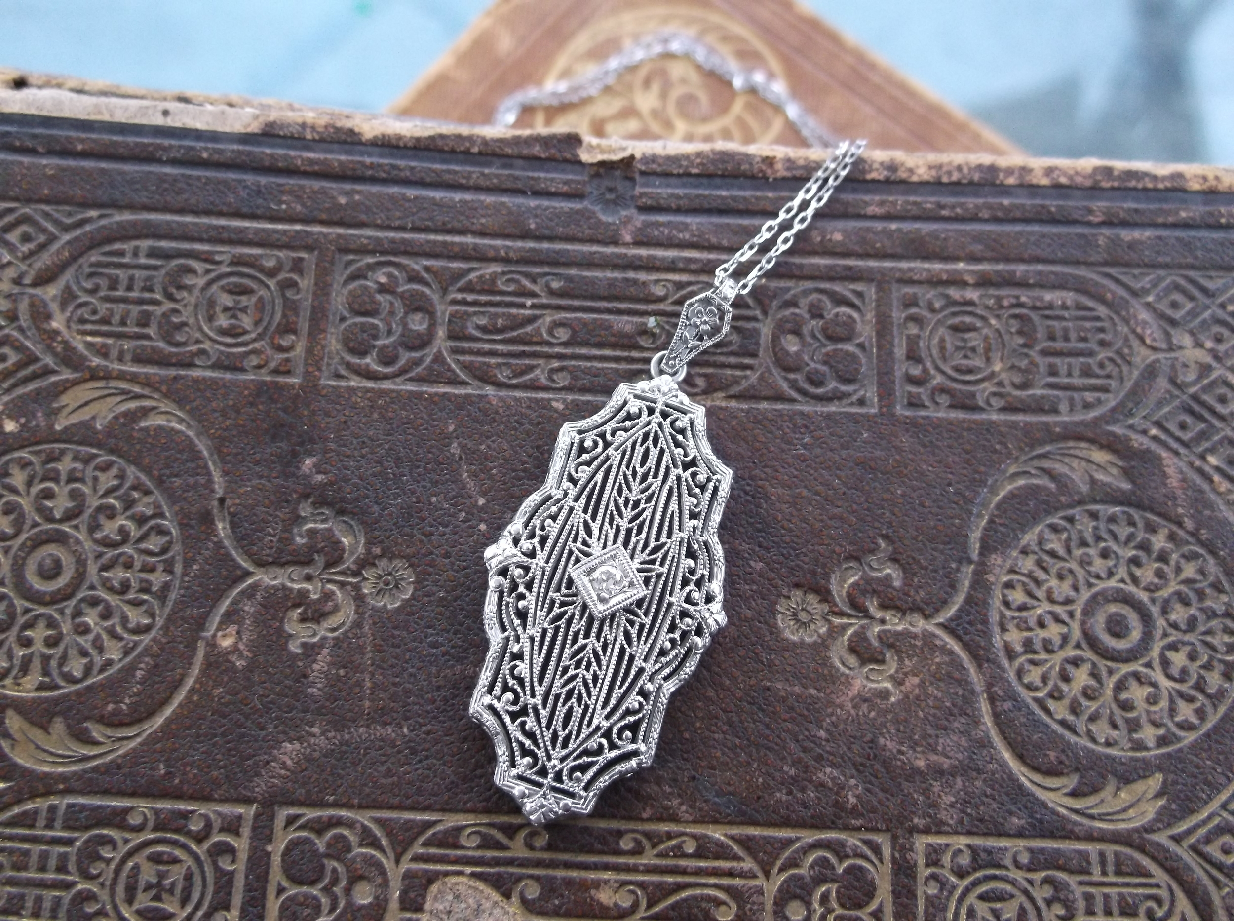 Walton's donation: beautiful Art Deco white gold filigree and diamond pendant.