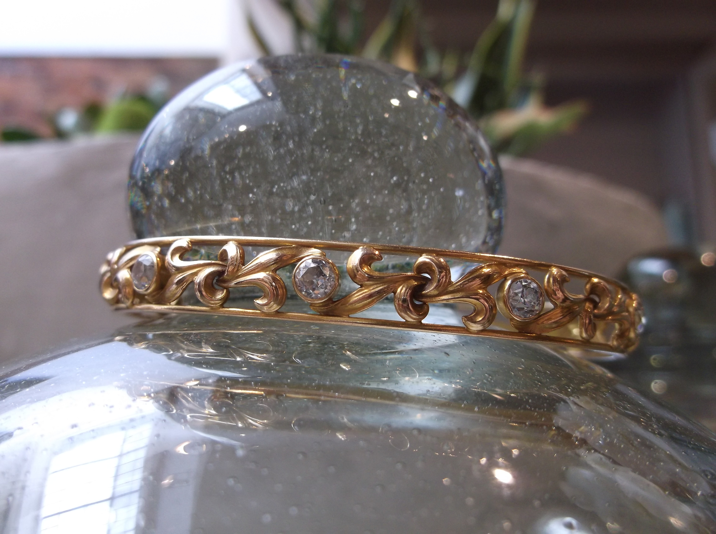 SOLD - Lovely circa 1900 diamond and yellow gold bangle bracelet with 1.50 carats total weight in Old Mine cut diamonds.