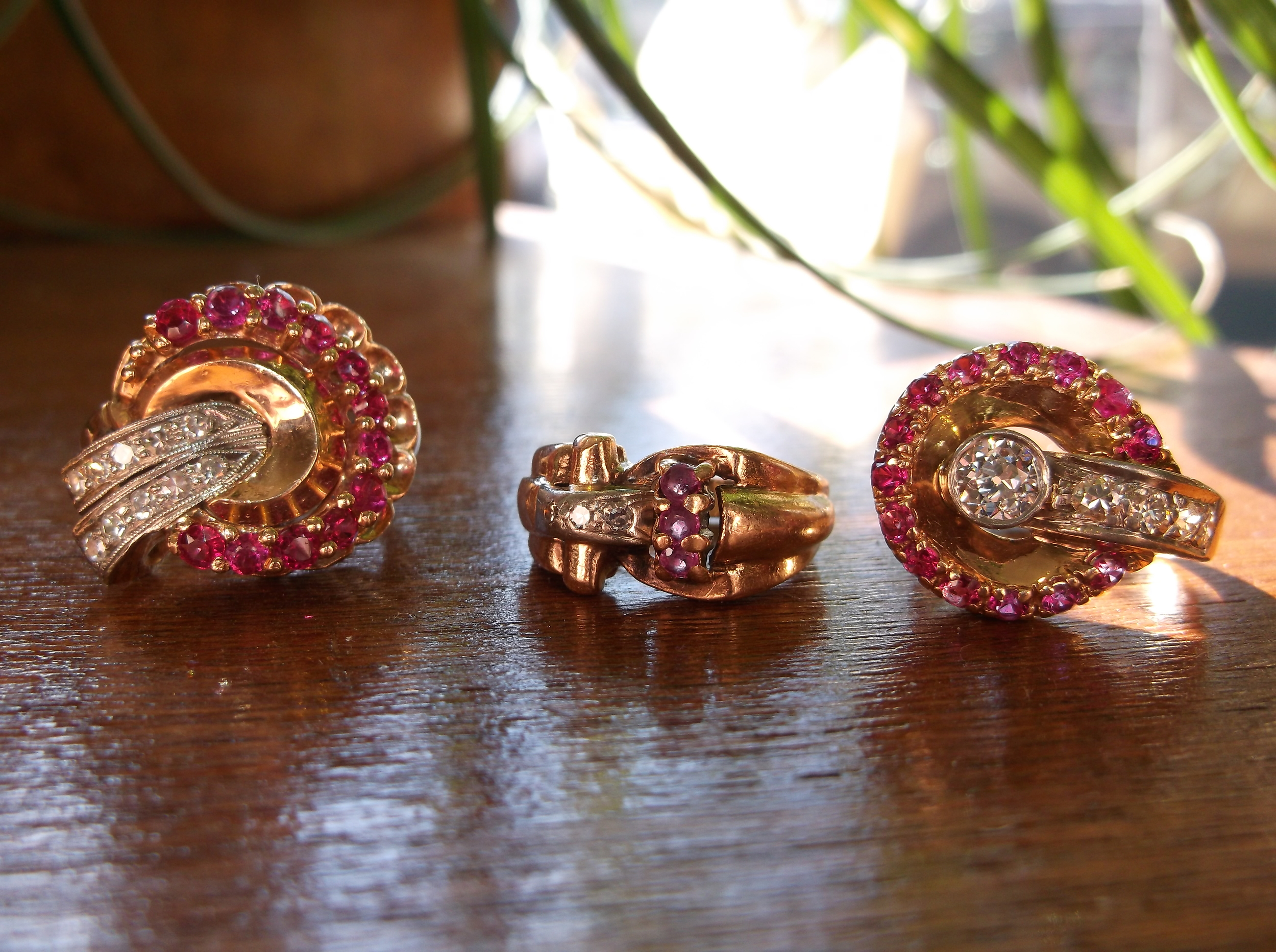 Three regally retro diamond, ruby and yellow gold rings! From left to right: SOLD - 1940's circular diamond and synthetic ruby ring in 14K yellow gold, SOLD - 1940's dainty diamond and ruby ring in 10K yellow gold, SOLD - 1940's diamond and ruby ring set in 14K yellow gold with a 0.45 carat diamond in the center.