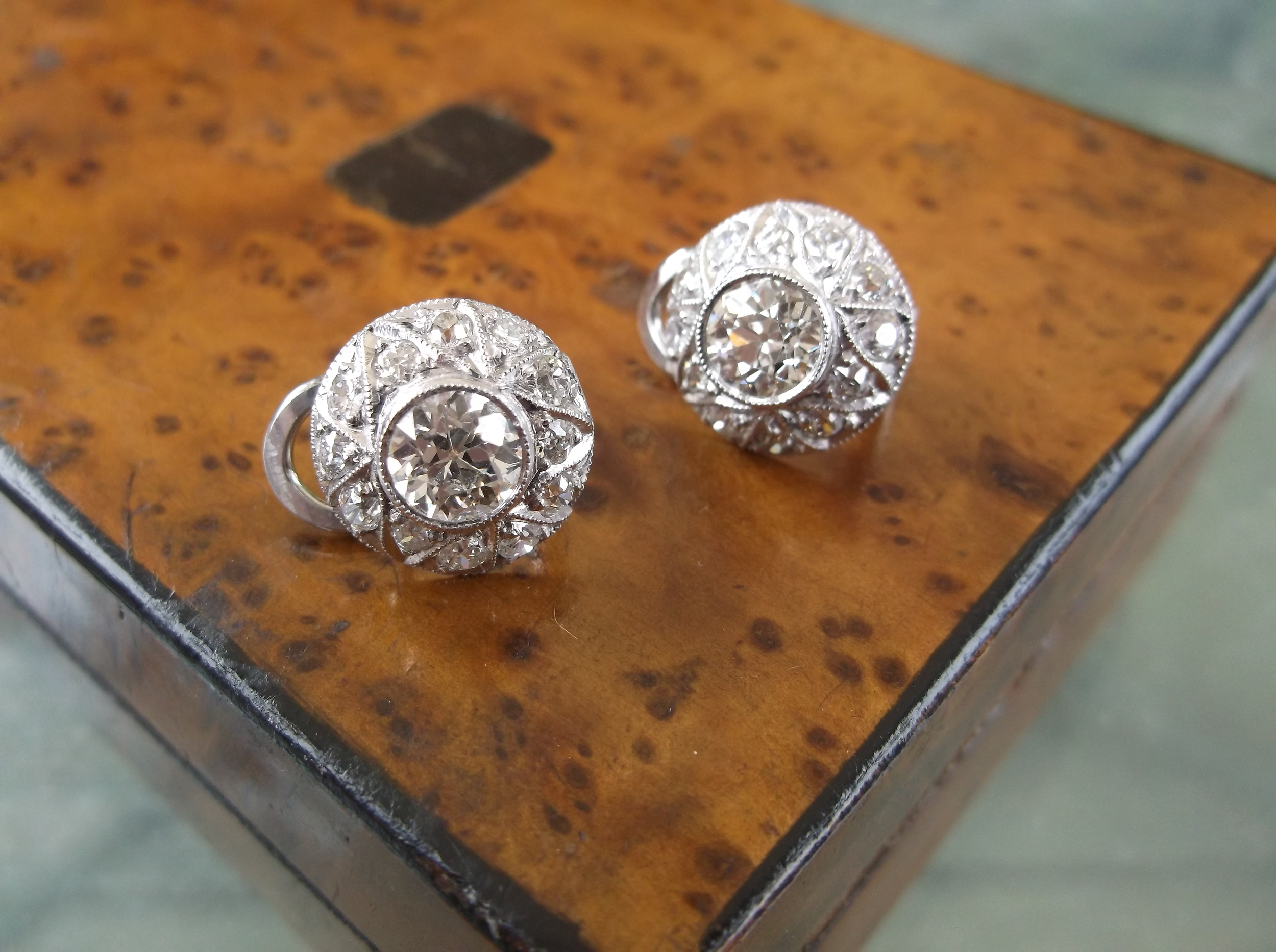 SOLD - Gorgeous Art Deco diamond and platinum earrings with a 0.90 carat Old European cut diamond in the center of each.