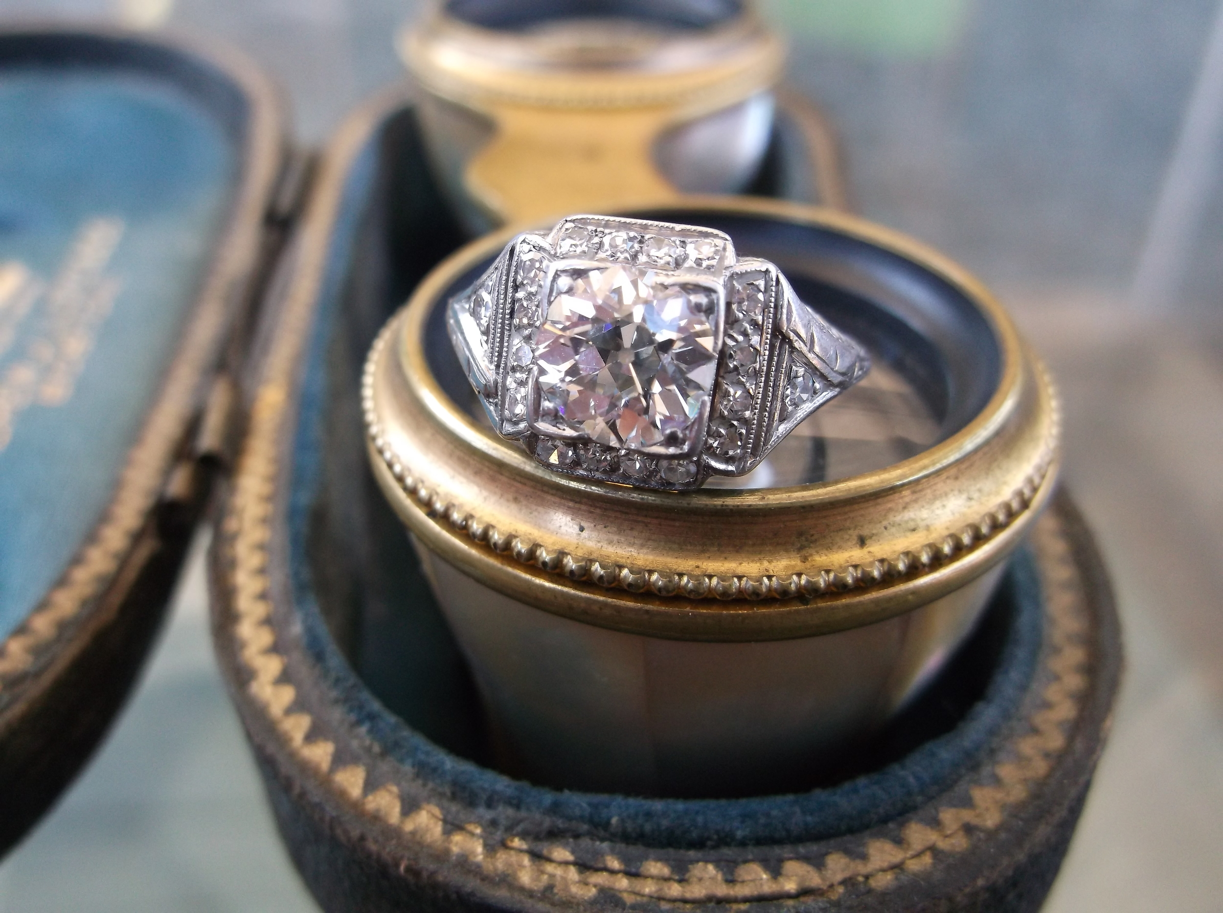 SOLD - Extraordinary 1920's 1.25 carat Old European cut diamond ring set in a platinum and diamond detail mounting.