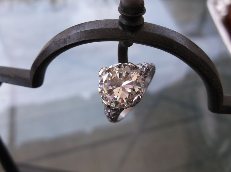 Walton's Jewelry example: 3.50 carat Round Brillant diamond set in an Art Deco style diamond detail mounting.