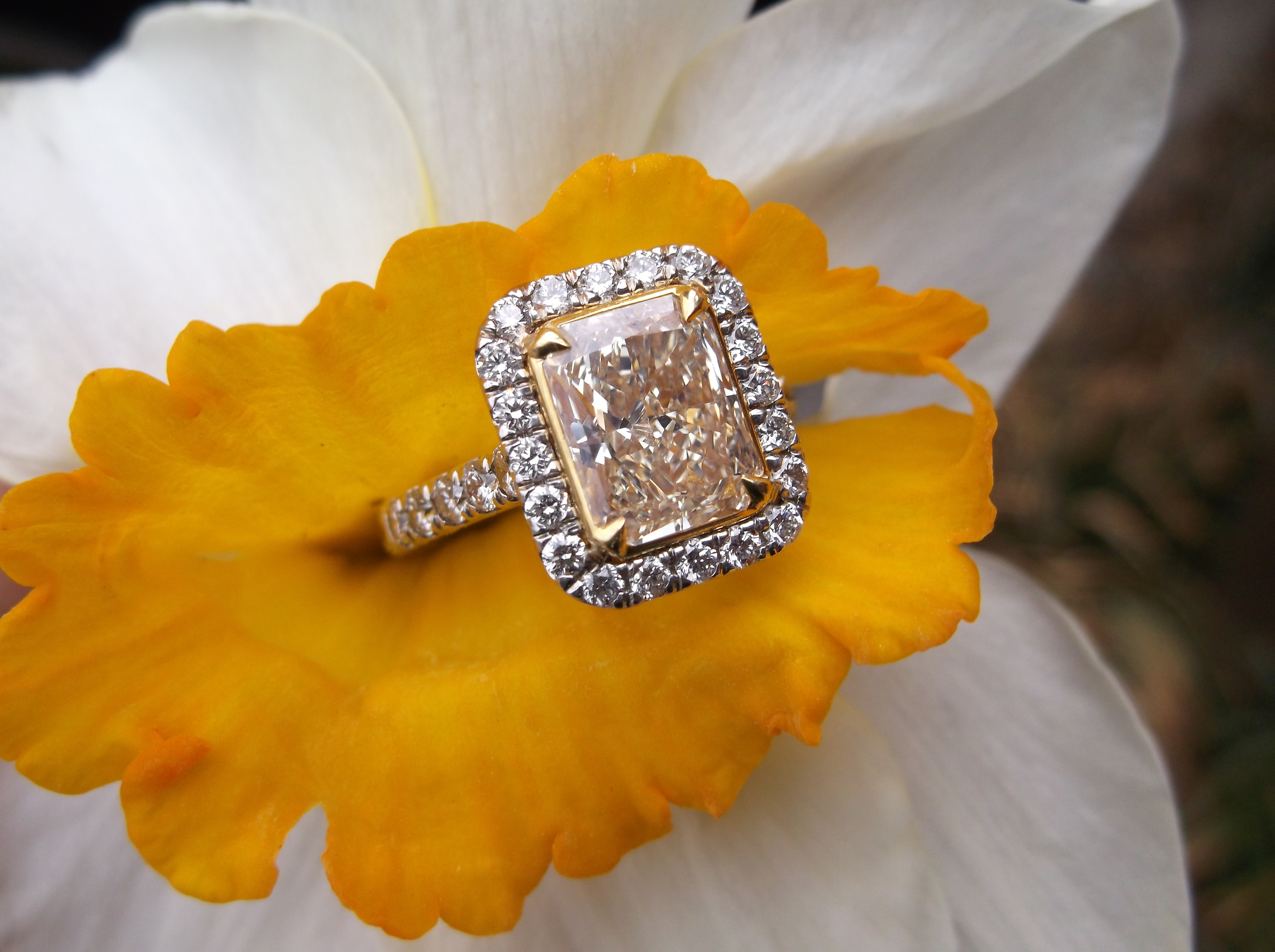 SOLD - Divine 2.36 carat Fancy Intense yellow diamond set in an 18K white gold and diamond mounting.