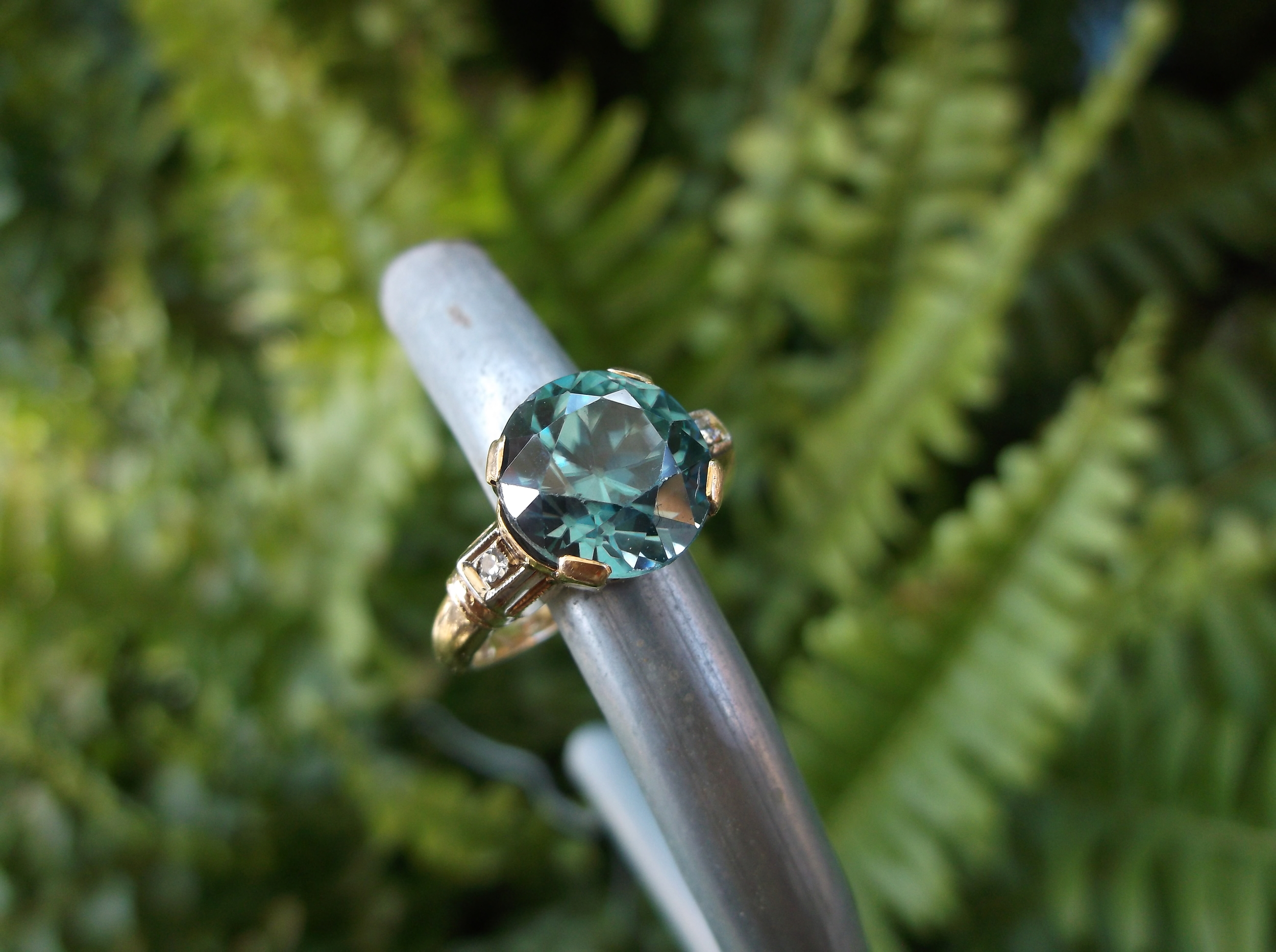 SOLD - Impressive 1940's Retro 4.50 carat blue zircon set in a rose gold and diamond setting!