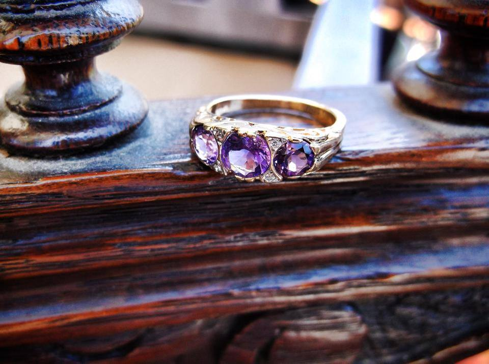 SOLD - Lovely amethyst ring set in yellow gold with little diamond detail.