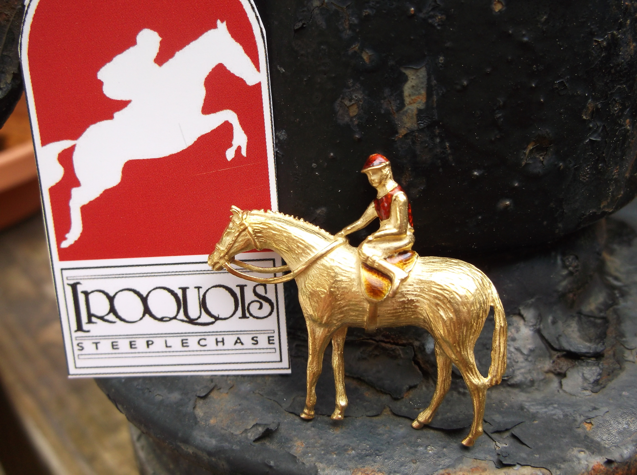 "SOLD - The perfect pin for you Iroquois Steeplechase attire! Beautiful 18K yellow gold horse and jockey pin with enameling on the jockey's silks! The pin is approximately 1.5"" wide by 1.5"" in height."