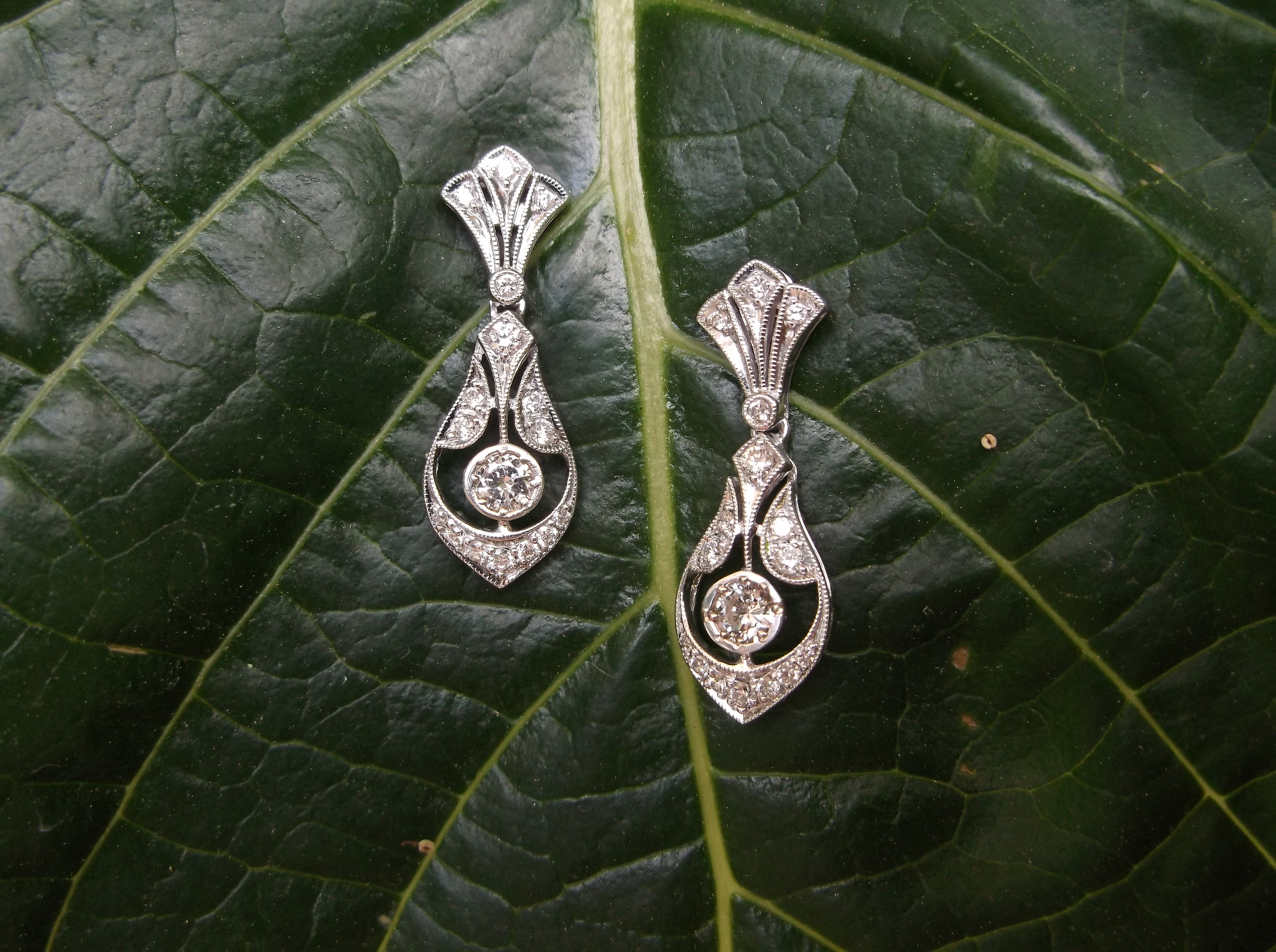 SOLD - Elegant diamond drop earrings with 0.54 carats total weight in diamonds set in white gold.