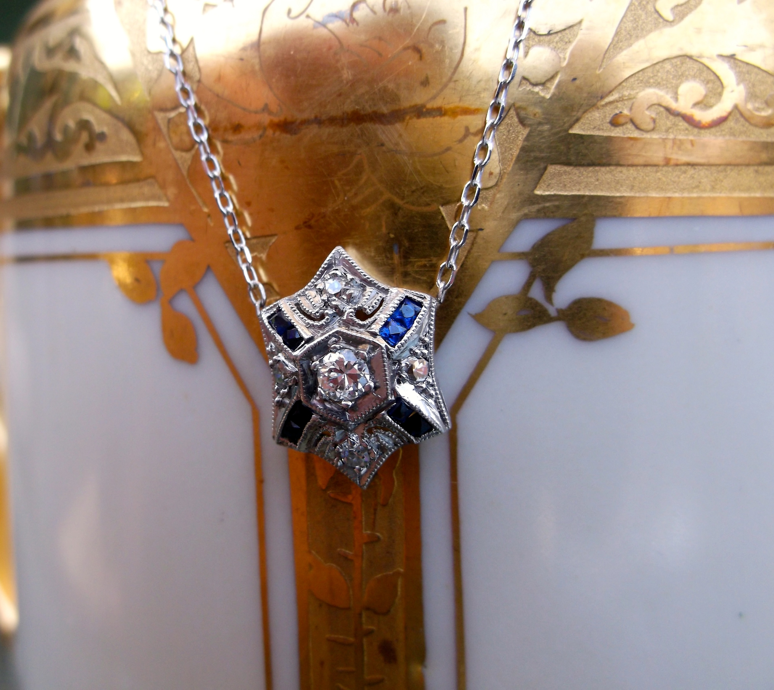 "SOLD - Intricate Art Deco diamond and sapphire pendant set in white gold. (The pendant is approximately 0.5"" in length.)"