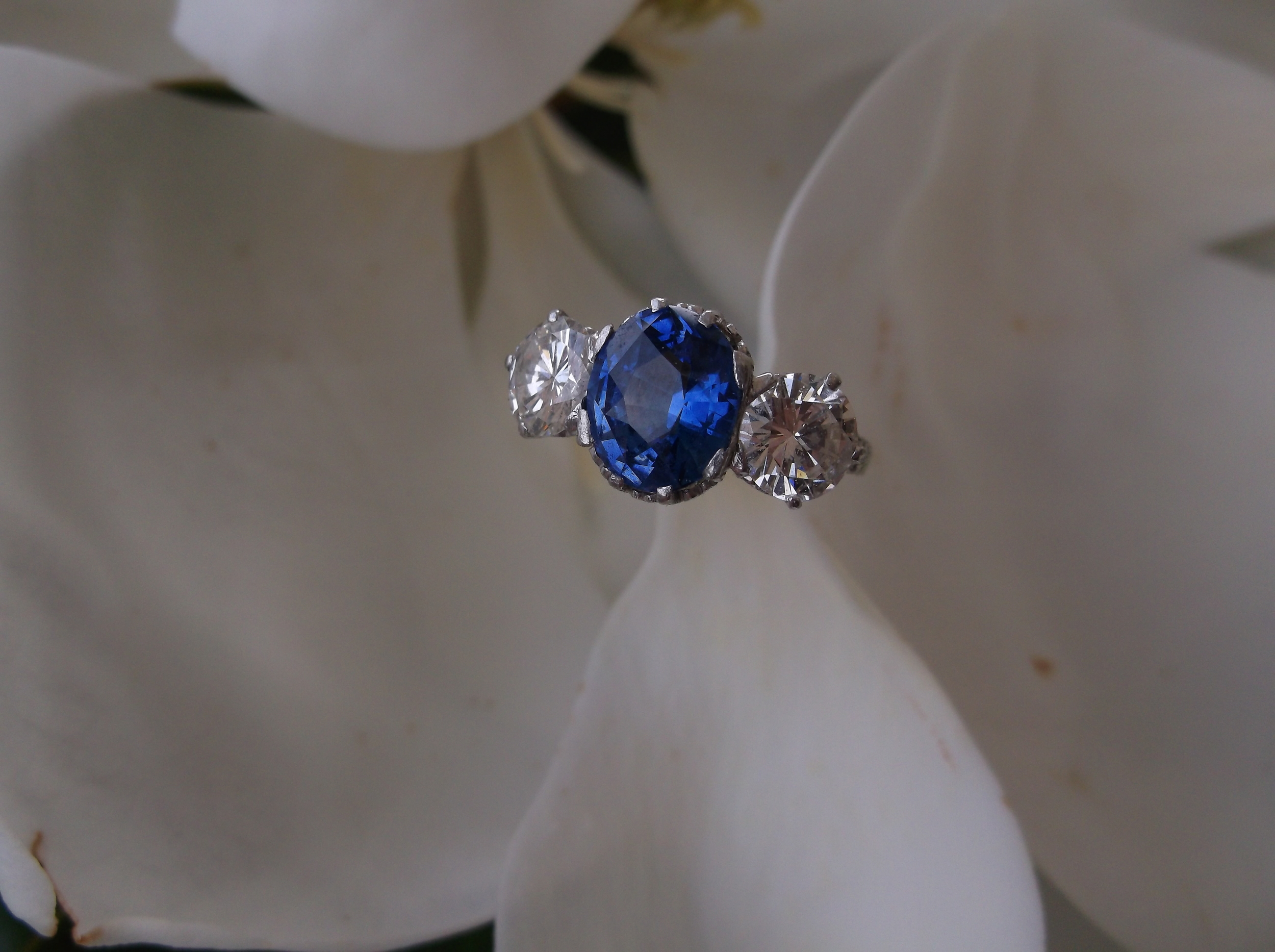 In 1980, Melba's experienced a total loss in the robbery that occurred at her jewelry store in Carter's Court. In 1982, the stolen jewelry was located in Phoenix, Arizona. This particular ring was one of recovered pieces, an Art Deco diamond and sapphire ring.