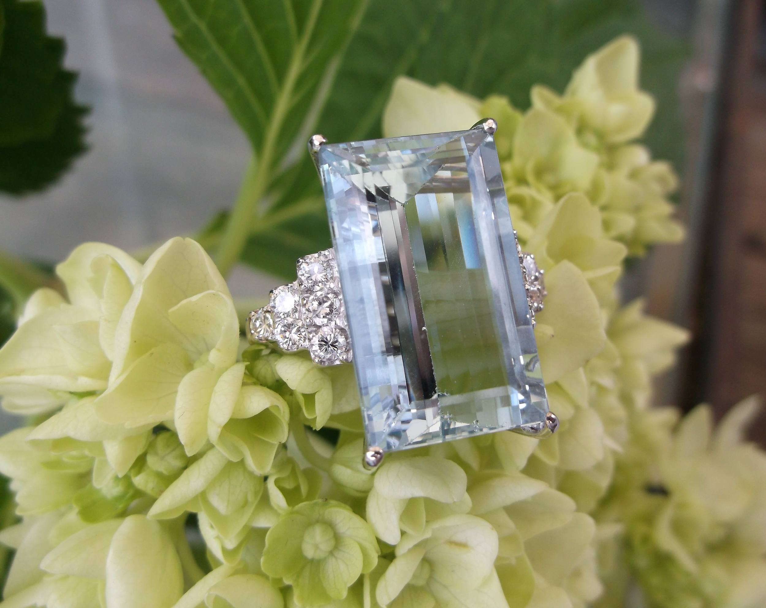 SOLD - Stunning 18.10 carat aquamarine set in an 18K white gold mounting with 0.75 carats total weight in diamonds.