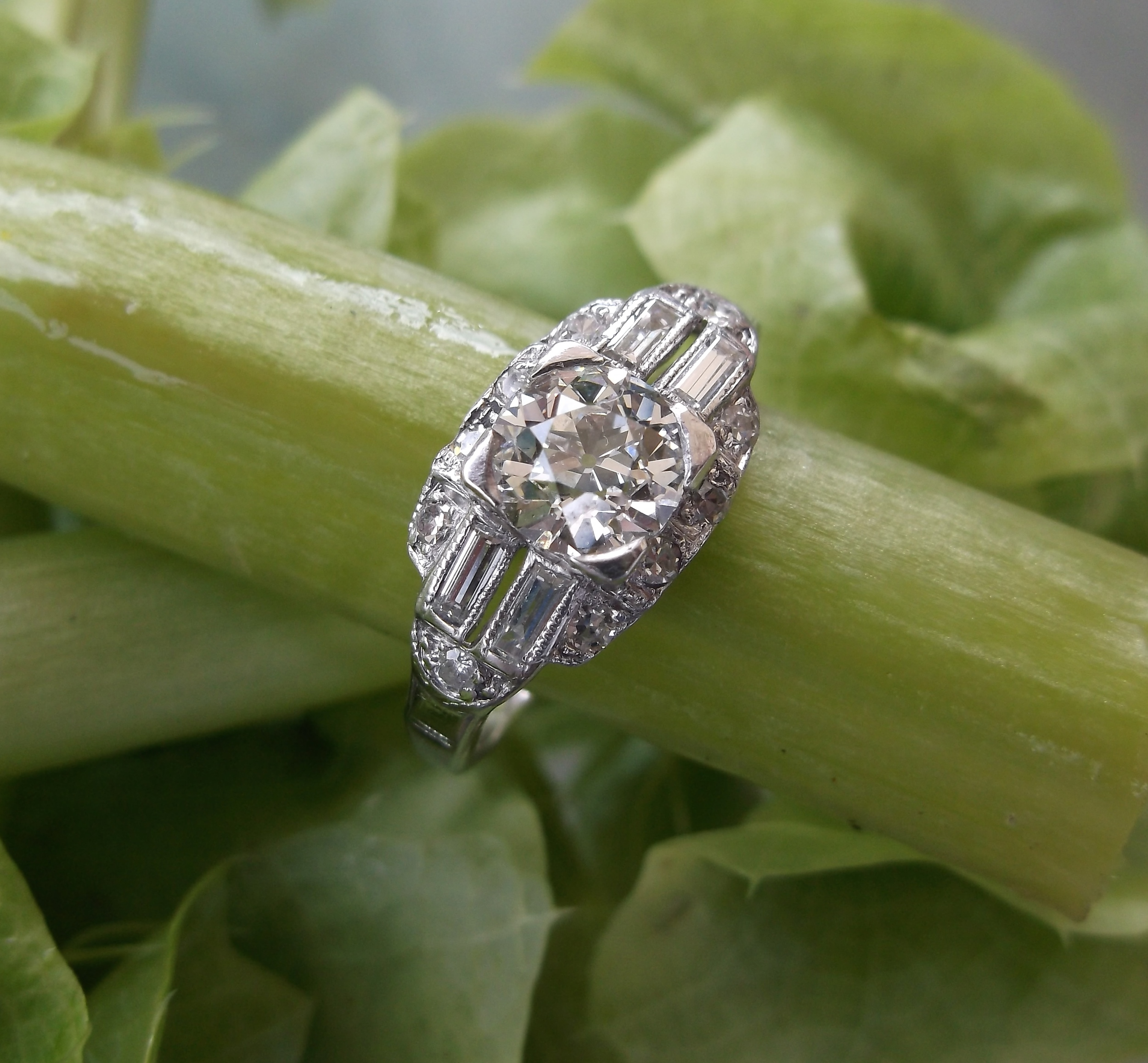 SOLD - Classic Art Deco 0.70 carat Old European cut diamond set in platinum ring with round and baguette diamond detail.